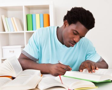 Young African Man Studying